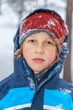Retrato de um menino no inverno fotografia de stock royalty free