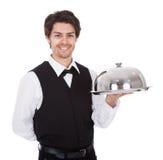 Retrato de um mordomo com laço e bandeja de curva Fotografia de Stock