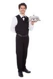 Retrato de um mordomo com laço e bandeja de curva Foto de Stock Royalty Free