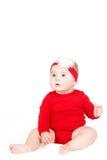Retrato de um vermelho infantil adorável feliz de lin do bebê da criança que senta o sorriso feliz em um fundo branco Fotografia de Stock