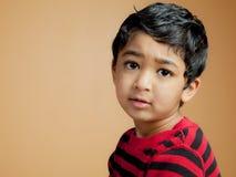 Retrato de uma criança considerável Fotos de Stock
