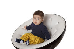 Retrato de uma criança na cadeira Imagens de Stock