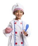 Retrato de uma criança vestida como o cozinheiro chefe Fotografia de Stock Royalty Free