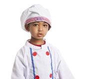 Retrato de uma criança vestida como o cozinheiro chefe Fotos de Stock Royalty Free