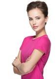 Retrato de uma jovem mulher bonita com emoções calmas na cara Imagem de Stock Royalty Free
