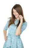 Retrato de uma jovem mulher bonita em um vestido de turquesa no whit Fotos de Stock Royalty Free