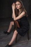 Retrato de uma menina com olhos tristes Imagens de Stock Royalty Free