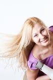 Retrato de uma menina com um hairdryer Fotografia de Stock