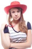 Retrato de uma menina em um chapéu vermelho Fotos de Stock Royalty Free