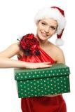 Retrato de uma menina na imagem Santa com um presente fotos de stock royalty free