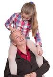 Retrato de uma menina que aprecia o passeio do reboque com ela grande Imagem de Stock Royalty Free