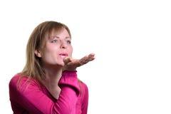 Retrato de uma menina que funde um ar Fotografia de Stock