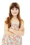 Retrato de uma moça bonito que está com mãos dobradas imagens de stock royalty free