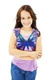 Retrato de uma moça bonito que está com mãos dobradas foto de stock royalty free