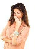 A mulher bonita cobre a boca com a mão Fotografia de Stock