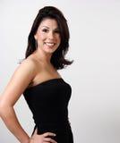 Retrato de uma mulher bonita no preto Foto de Stock Royalty Free