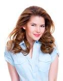 Retrato de uma mulher de sorriso nova bonita Fotografia de Stock Royalty Free