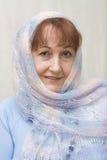 Retrato de uma mulher idosa. Imagens de Stock