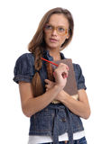 Retrato de uma mulher nova à moda do estudante imagem de stock