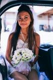Retrato de uma noiva asiática bonita nova em seu dia do casamento Imagem de Stock Royalty Free