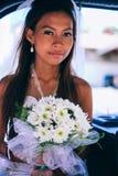 Retrato de uma noiva asiática bonita nova em seu dia do casamento Imagens de Stock