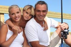 Retrato de uma pesca da família Fotografia de Stock