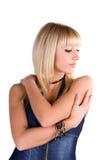 Retrato de uma rapariga bonita em um terno da sarja de Nimes Foto de Stock