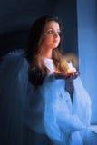 Retrato de un ángel con una vela Imágenes de archivo libres de regalías