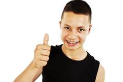 Retrato de un adolescente con los pulgares para arriba Fotografía de archivo libre de regalías