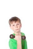 Retrato de un adolescente con pesas de gimnasia Fotos de archivo