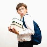 Retrato de un adolescente divertido con los libros Fotografía de archivo
