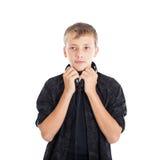 Retrato de un adolescente lindo con los auriculares Foto de archivo