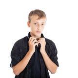 Retrato de un adolescente lindo con los auriculares Fotografía de archivo