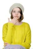 Retrato de un adolescente que cubre su boca con su palma encendido Fotos de archivo