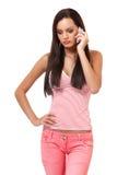 Retrato de un adolescente triste con el teléfono Fotografía de archivo libre de regalías