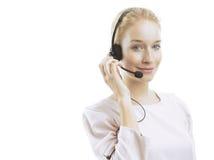 Agente femenino joven confiado del servicio de atención al cliente con las auriculares Fotos de archivo