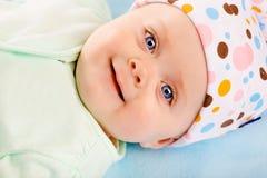 Retrato de un bebé sonriente Fotografía de archivo