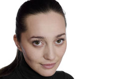 Retrato de un brunette hermoso en el fondo blanco Imágenes de archivo libres de regalías