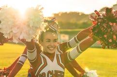 Retrato de un cheerleeder en la acción Fotografía de archivo libre de regalías
