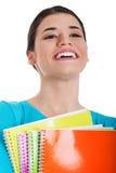 Retrato de un estudiante hermoso joven con el libro de trabajo. Imagen de archivo libre de regalías