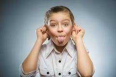 Retrato de un hermoso y feliz con la lengua hacia fuera Imágenes de archivo libres de regalías
