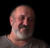 Retrato de un hombre adulto con una barba y una cara divertida Fotos de archivo