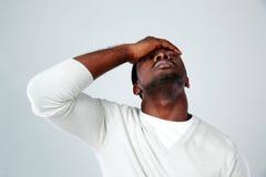 Retrato de un hombre africano cansado Foto de archivo