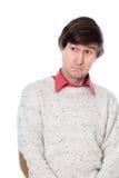 Retrato de un hombre confuso que mira a la cara. Foto de archivo libre de regalías