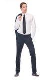 Retrato de un hombre de negocios joven que sostiene la chaqueta negra del traje Foto de archivo