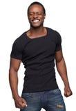 Hombre del afroamericano que sonríe con los ojos cerrados Fotos de archivo libres de regalías