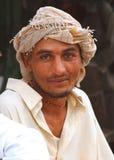 Retrato de un hombre en la playa de Clifton, Karachi Foto de archivo libre de regalías