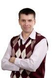 Retrato de un hombre en un chaleco y una camisa de la tela escocesa Fotos de archivo