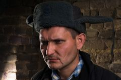 Retrato de un hombre en un uniforme para una granja Imagen de archivo libre de regalías
