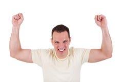 Retrato de un hombre feliz con sus brazos levantados imagen de archivo